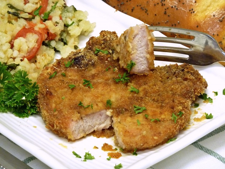 You can literally see how juice Parmesan Pork Chops are in this photo. Drool.