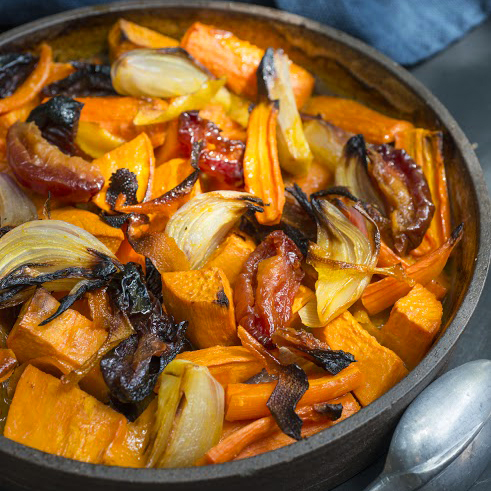 This updated version of tzimmes with carrots, sweet potatoes, and dried plums is good any day of the year.