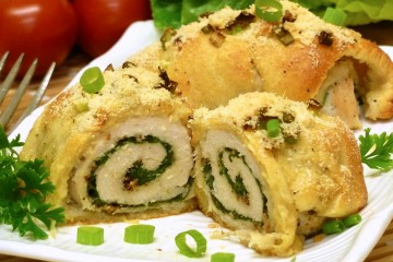 Pretty Spinach Chicken Roll-Ups are loaded with spinach, cheese, and bacon, then wrapped in flaky dough.