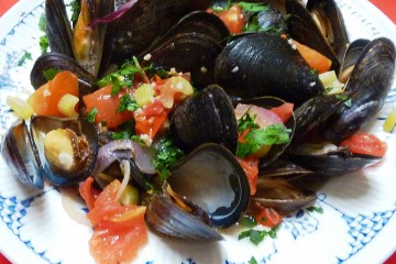Be sure to sop up the luscious broth when you eat these fabulous mussels in garlic tomato broth.