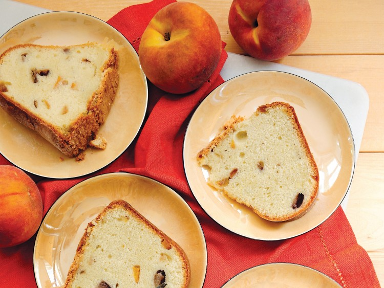 Peach almond pound cake is kissed with almonds to make you drool for more.