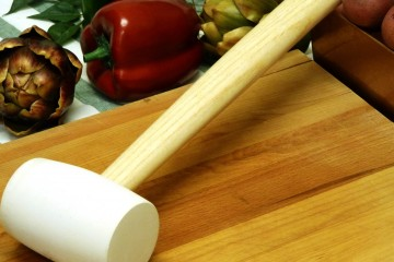Use a rubber mallet from the hardware store as a meat tenderizer.