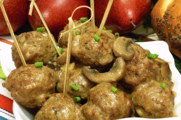 Flavorful mini meatballs with mushrooms serve as an entree or appetizer.