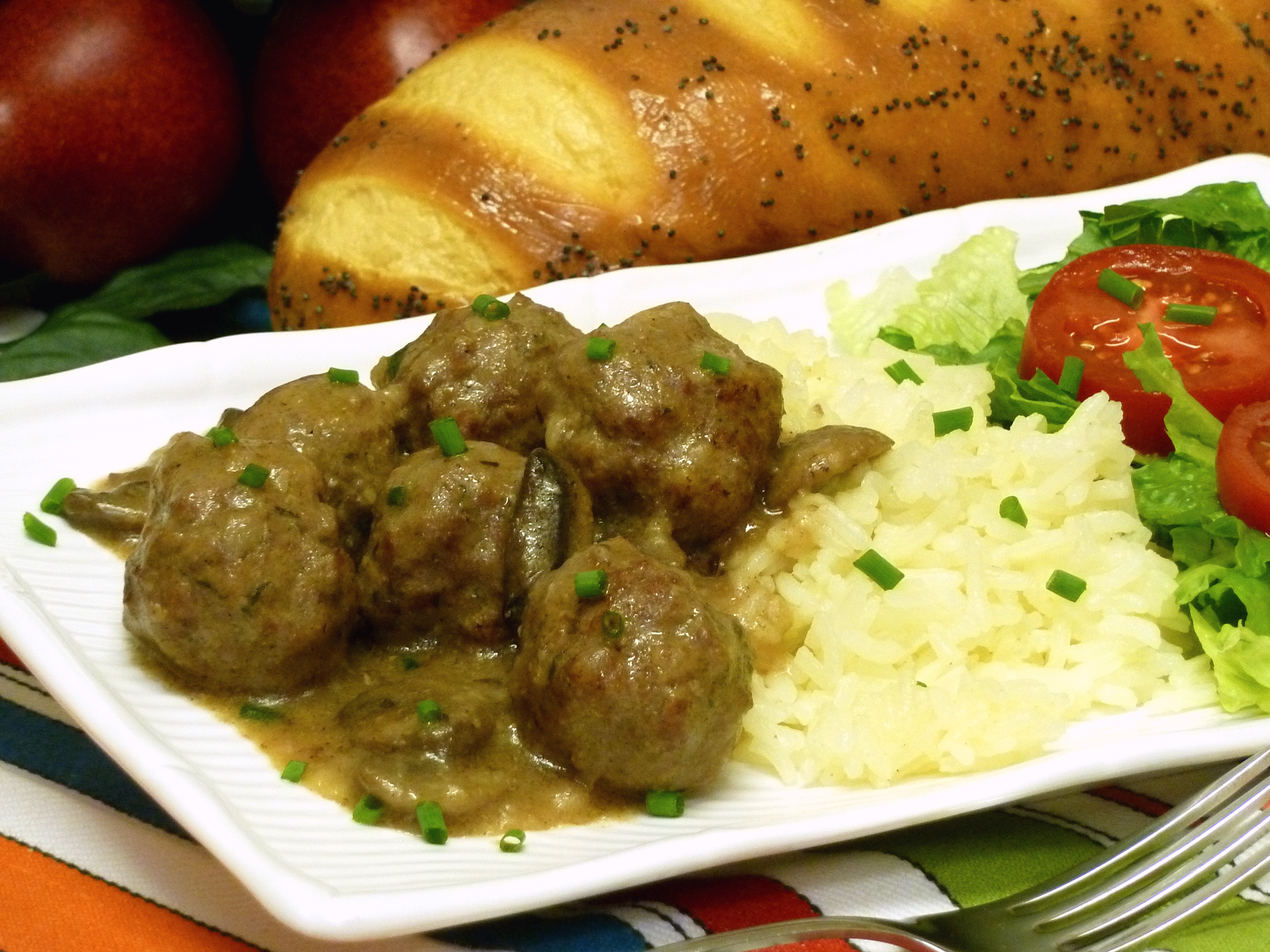 Enjoy flavorful mini meatballs as an entree with seasoned rice and a salad.