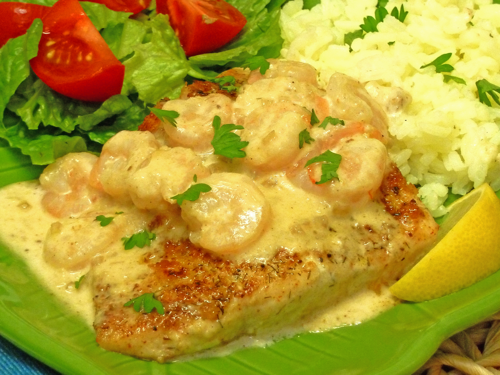 Delicious shrimp scampi sauce tops red snapper.