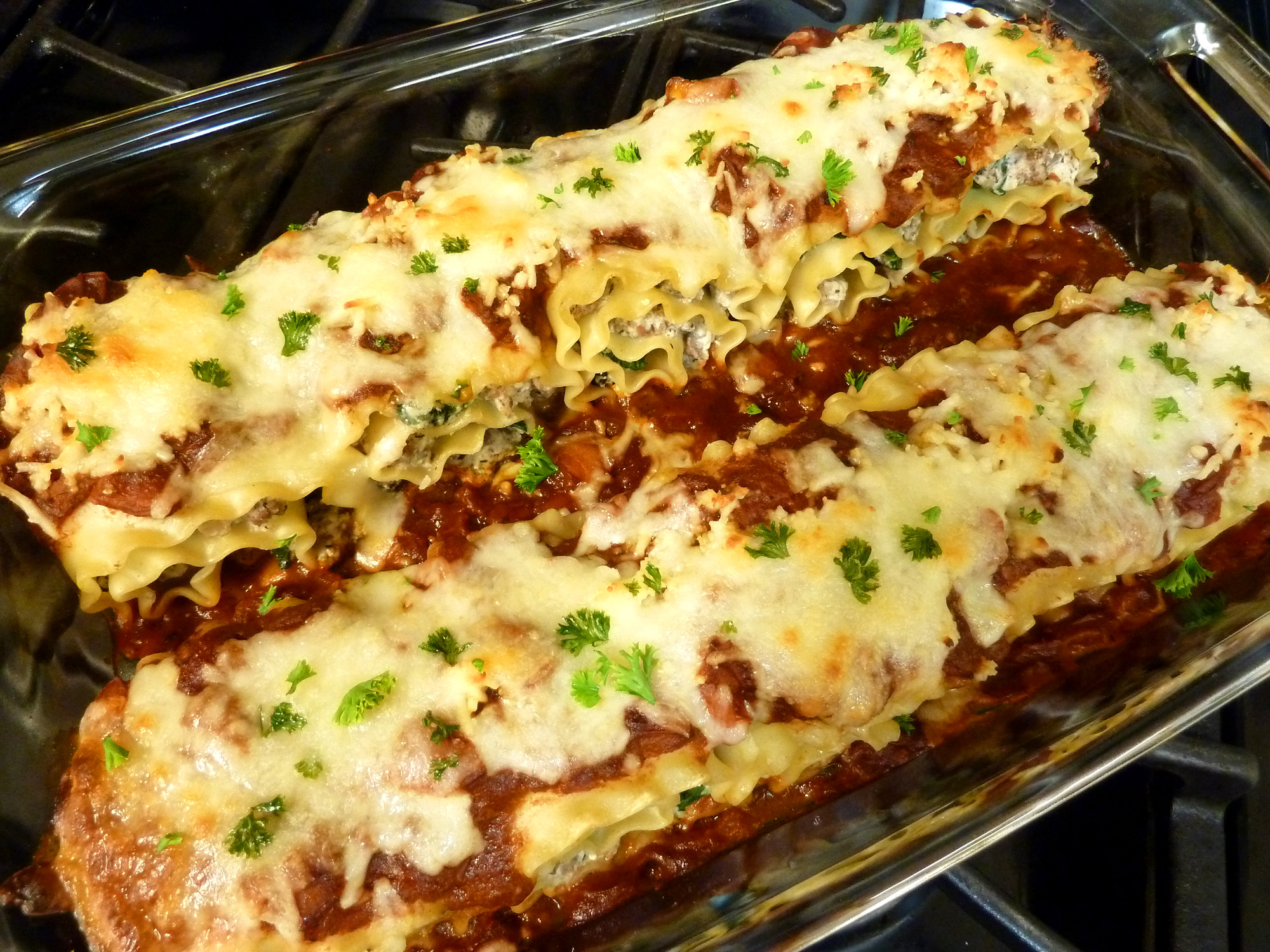 Dig into these hot stuffed lasagna rolls, straight from the oven.