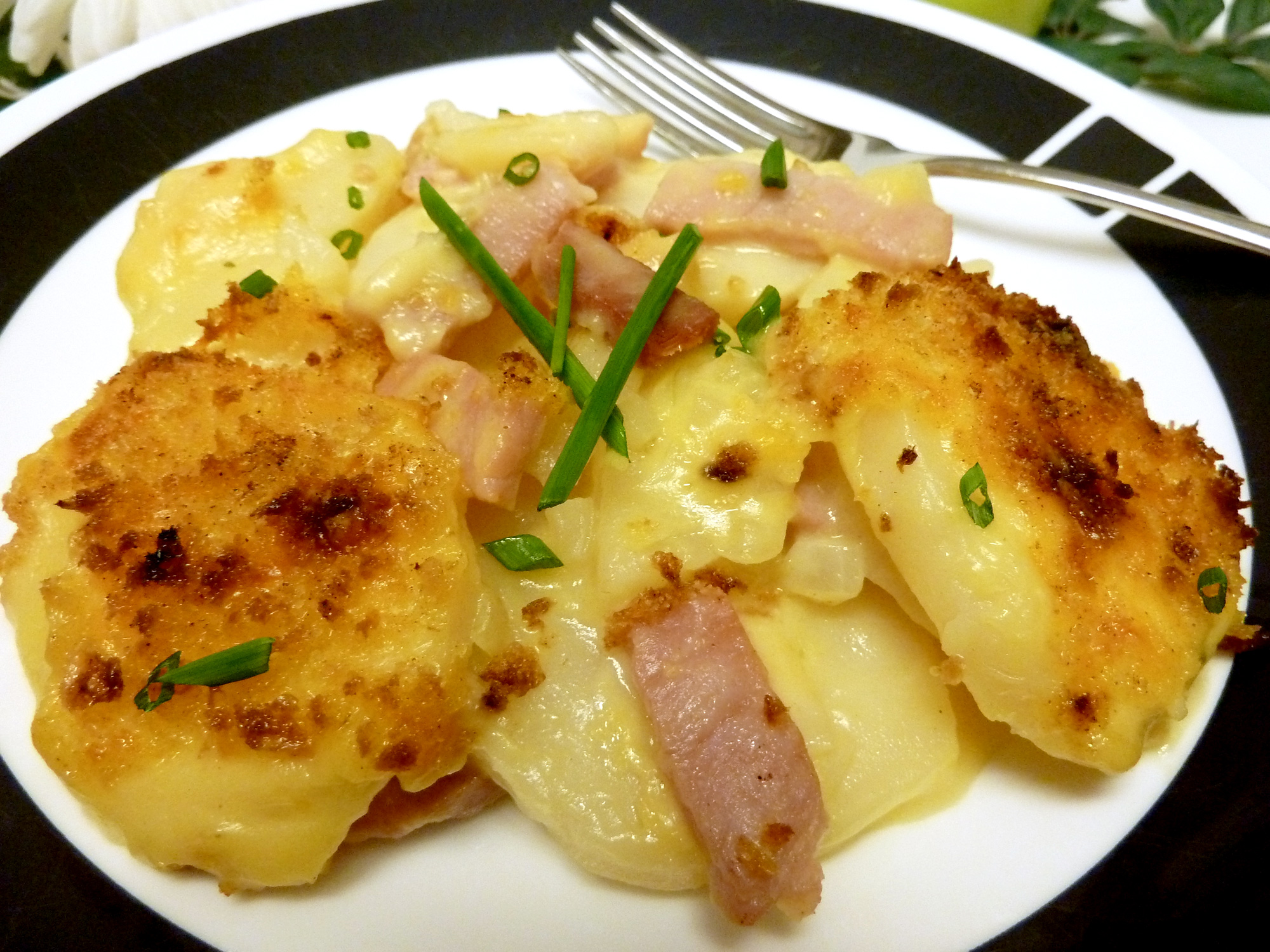 Cheesy scalloped potatoes with ham for a filling meal.