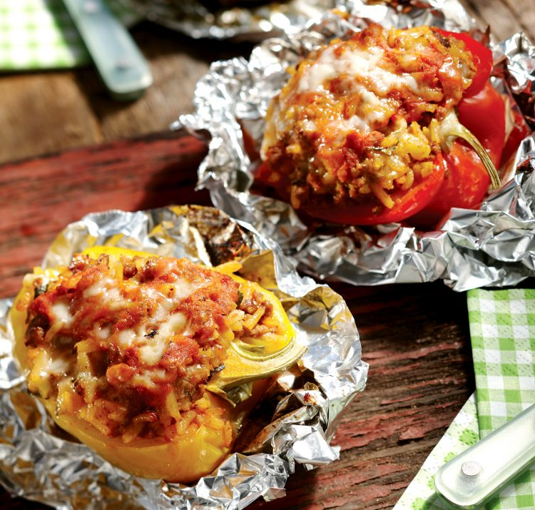 Colorful bell peppers are stuffed with Italian-style beef and rice in foil packets.