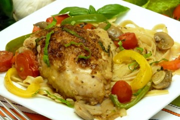 Tender chicken cacciatora celebrates the Italian flavors of chicken, oregano, basil, garlic, and fresh vegetables over pasta.