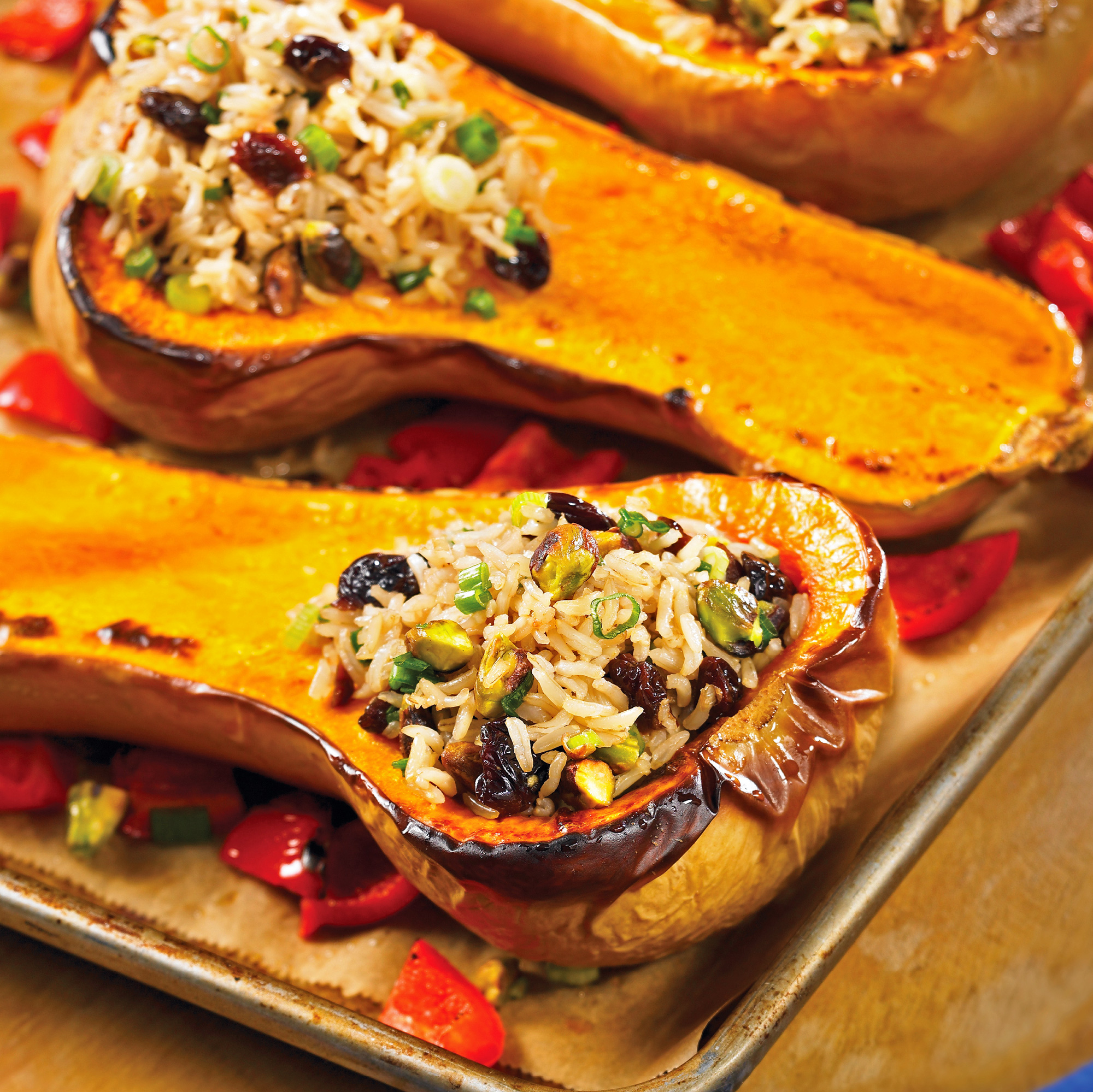 Savory stuffing of brown rice, dried cherries, and nuts lifts butternut squash to a new level.