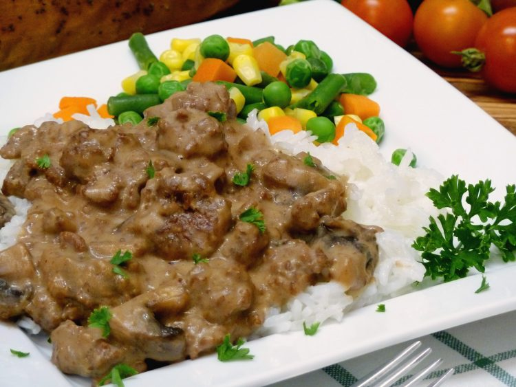Ground beef, sausage, and mushrooms make a chunky stroganoff perfect over rice or noodles.