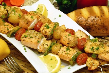 A delightfully different basting sauce makes salmon kebabs extra-special.