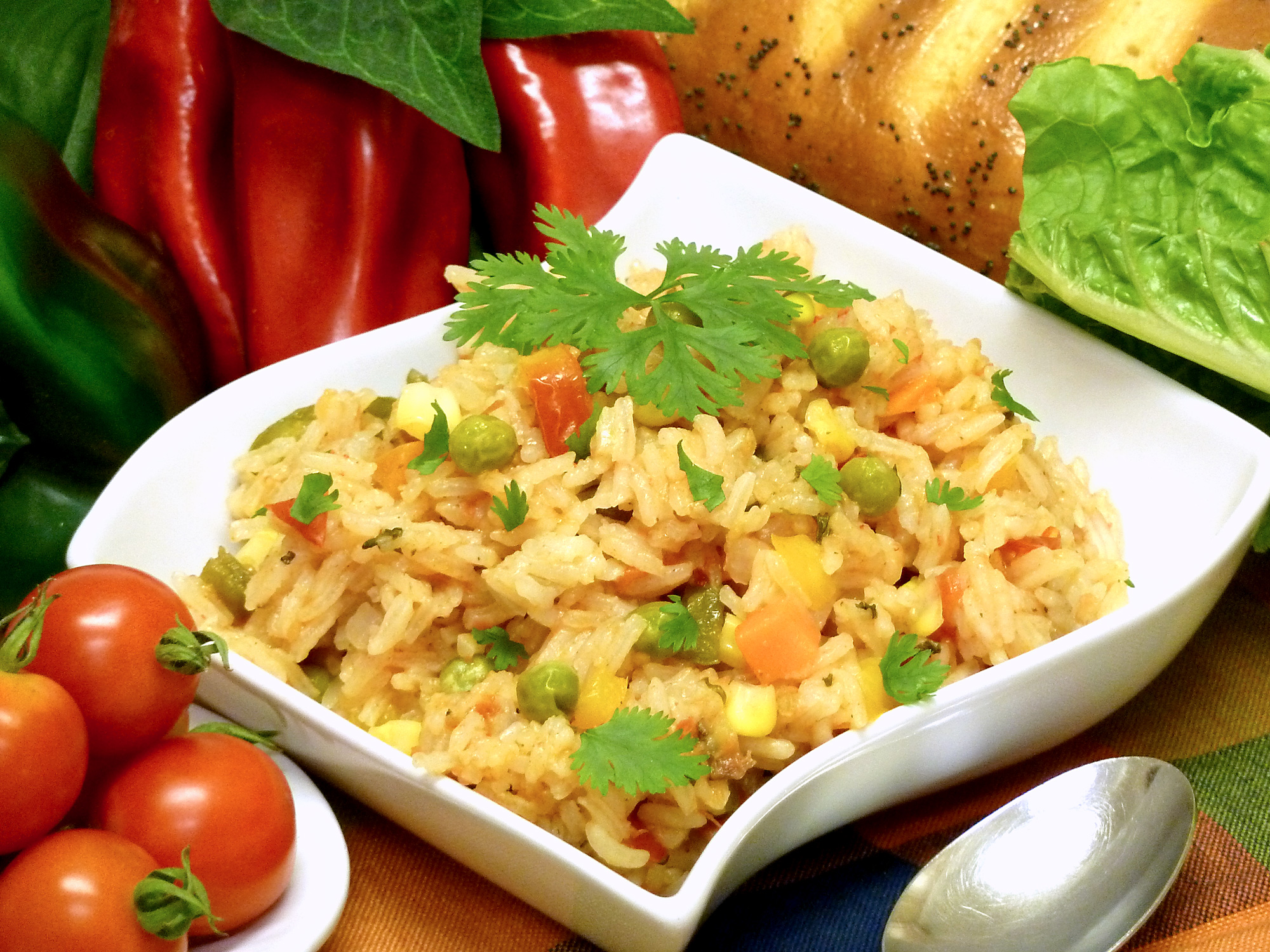 Salsa gives spanish rice with vegetables a slightly spicy punch of flavor.