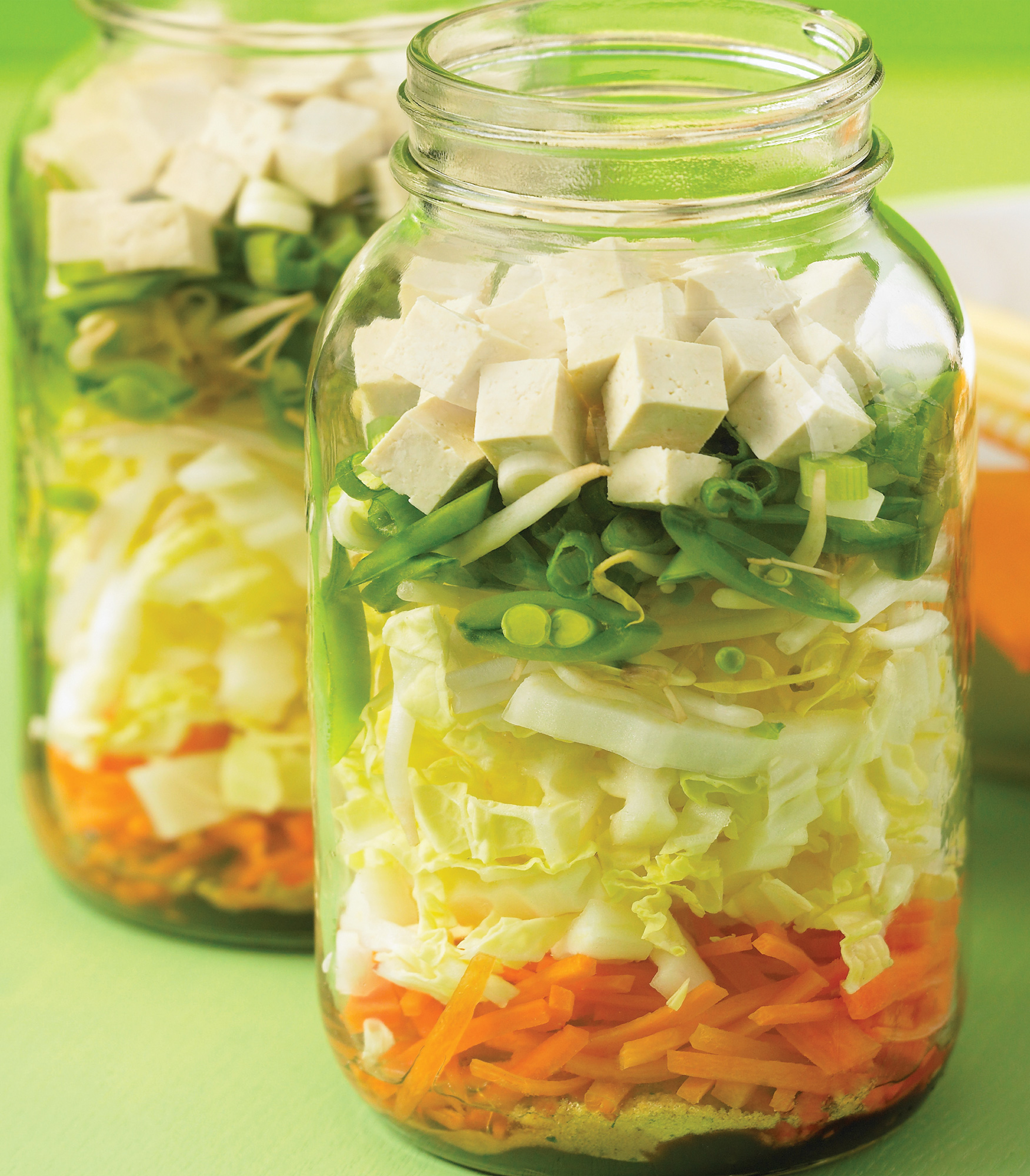 Deliciously fresh vegetable tofu soup is quickly cooked in a mason jar.