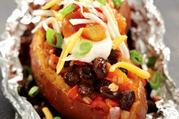 Loaded sweet potatoes get the Latin treatment with taco seasoning, black beans, salsa, and yogurt.