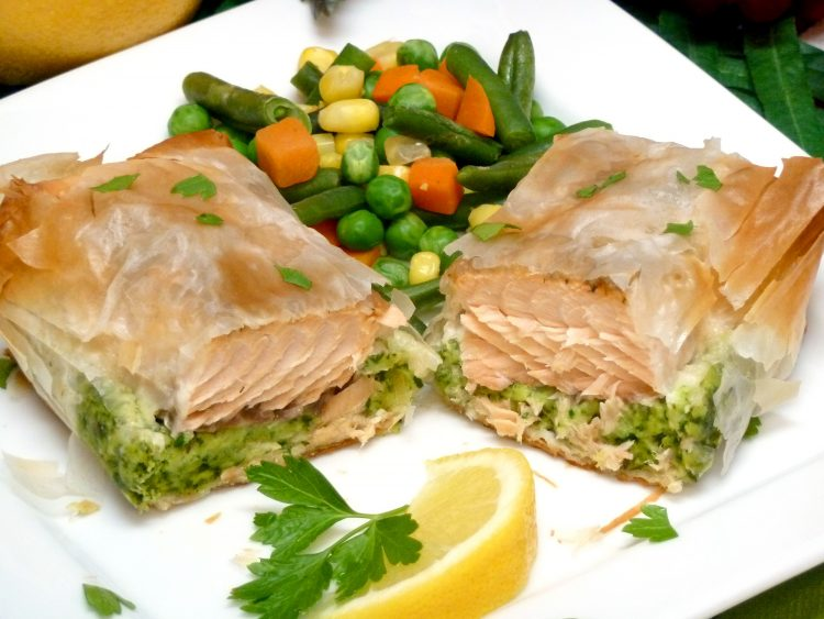 Delicious salmon with herbed spinach stuffing is wrapped in phyllo dough.