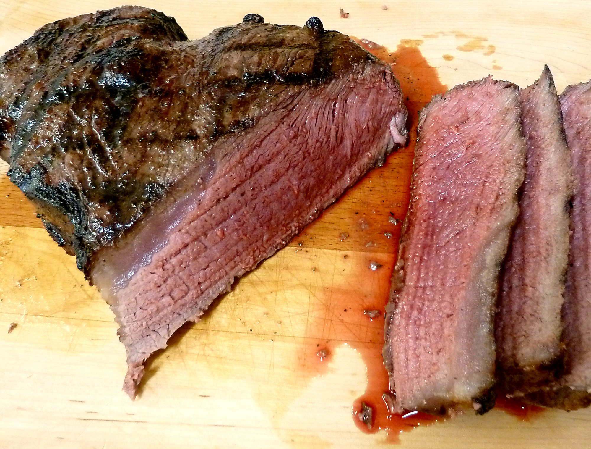 London broil has been marinated and grilled to juicy perfection, then sliced against the grain for maximum tenderness.