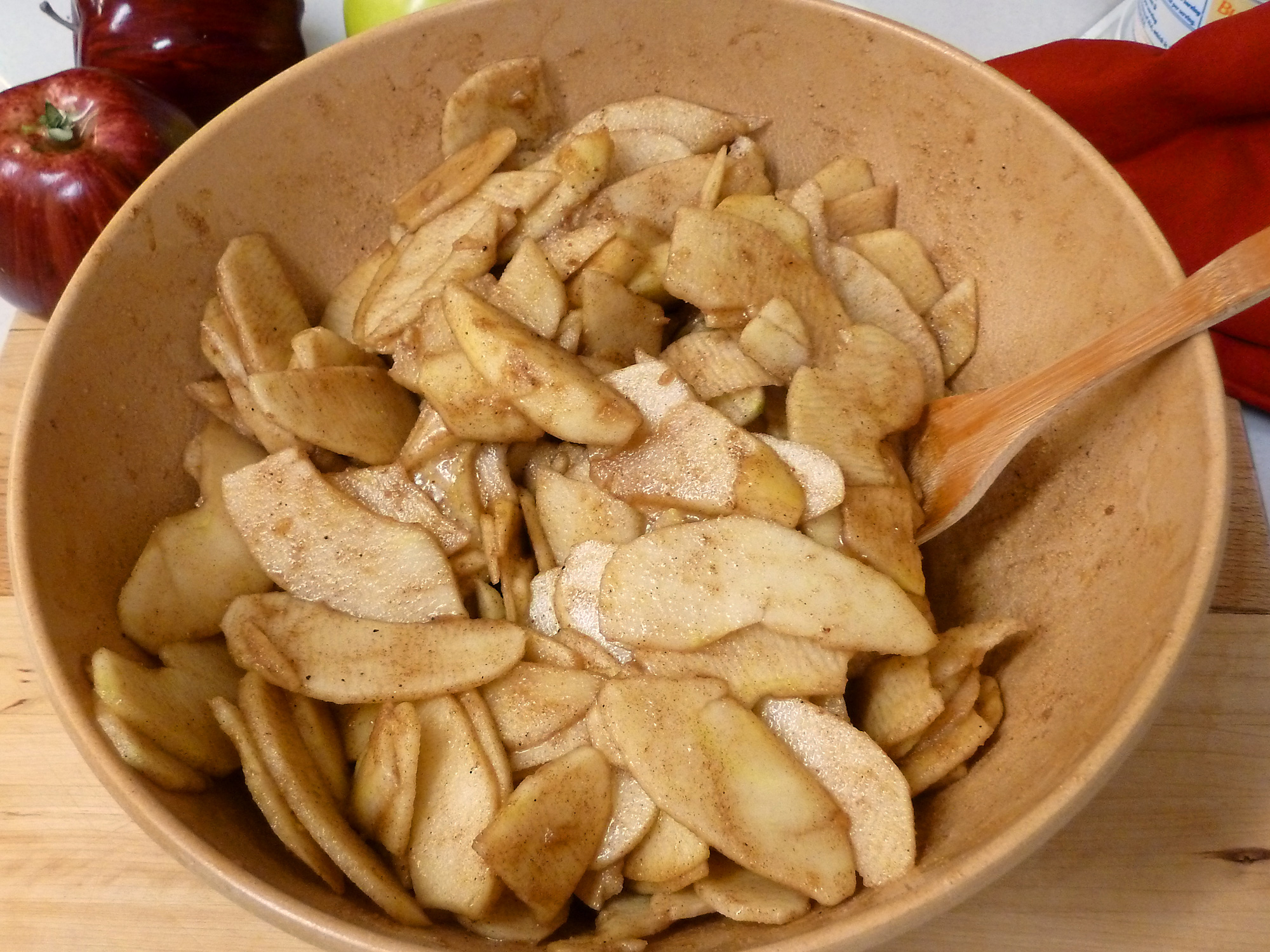 The apples are mixed with the Fireball Cinnamon Whiskey® and spices, ready to be covered with the crisp topping.
