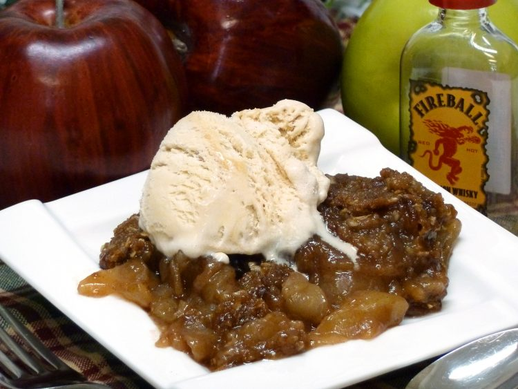 Luscious apple crisp is flavored with spicy Fireball Cinnamon Whiskey.