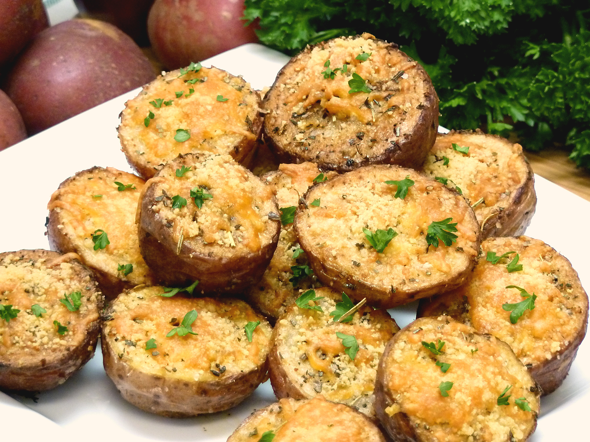 Crispy, golden red potatoes are spices with Italian herbs and topped with two cheeses.