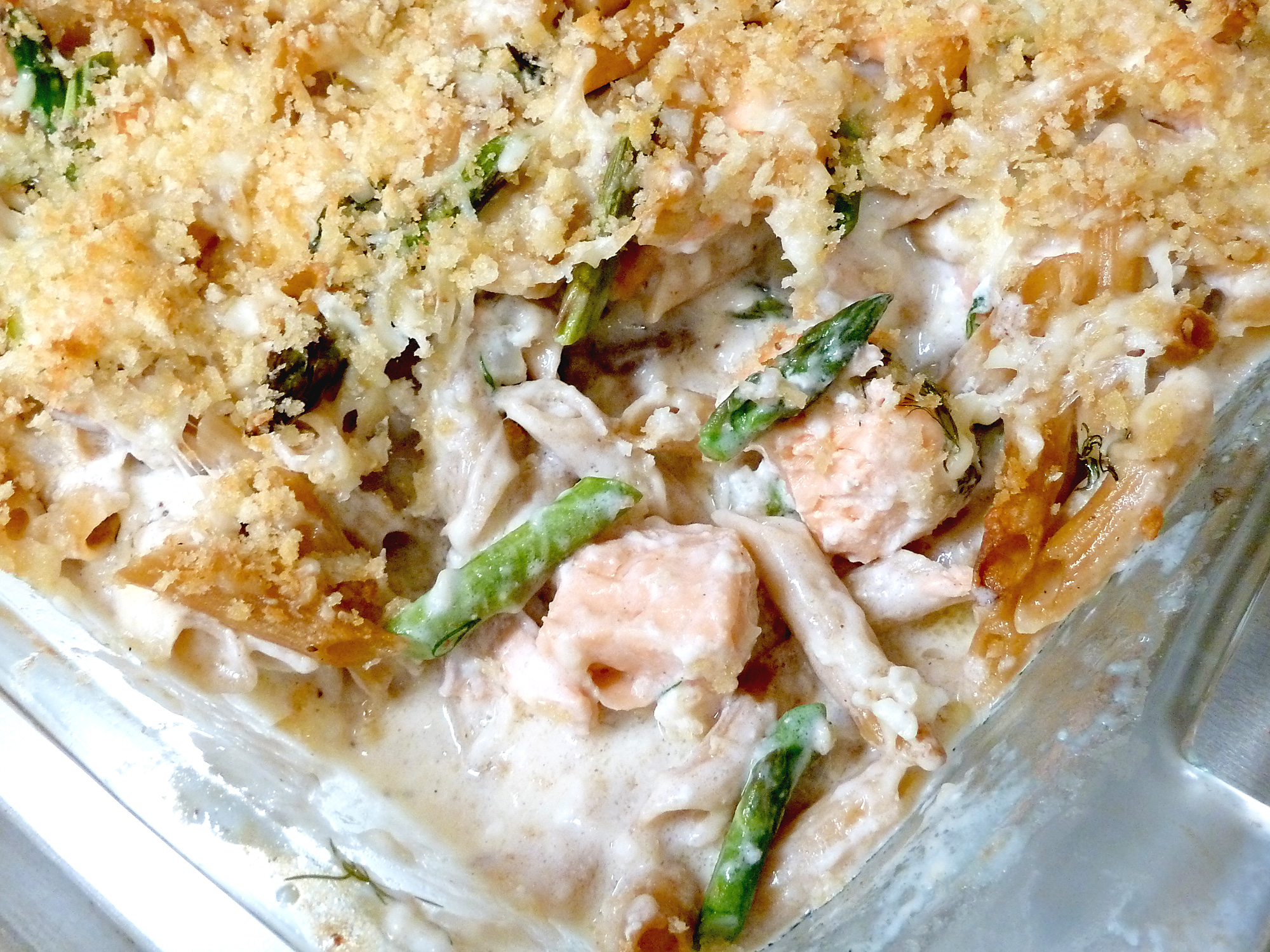 Fresh from the oven, salmon asiago casserole is loaded with salmon, asparagus, and cheesy alfredo seafood sauce.