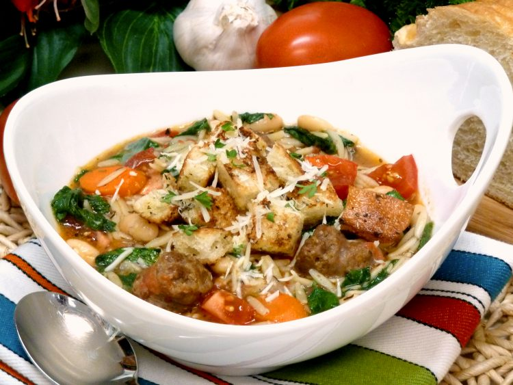 Italian sausage soup is loaded with fresh vegetables, white beans, and orzo for a nostalgic meal in a bowl.