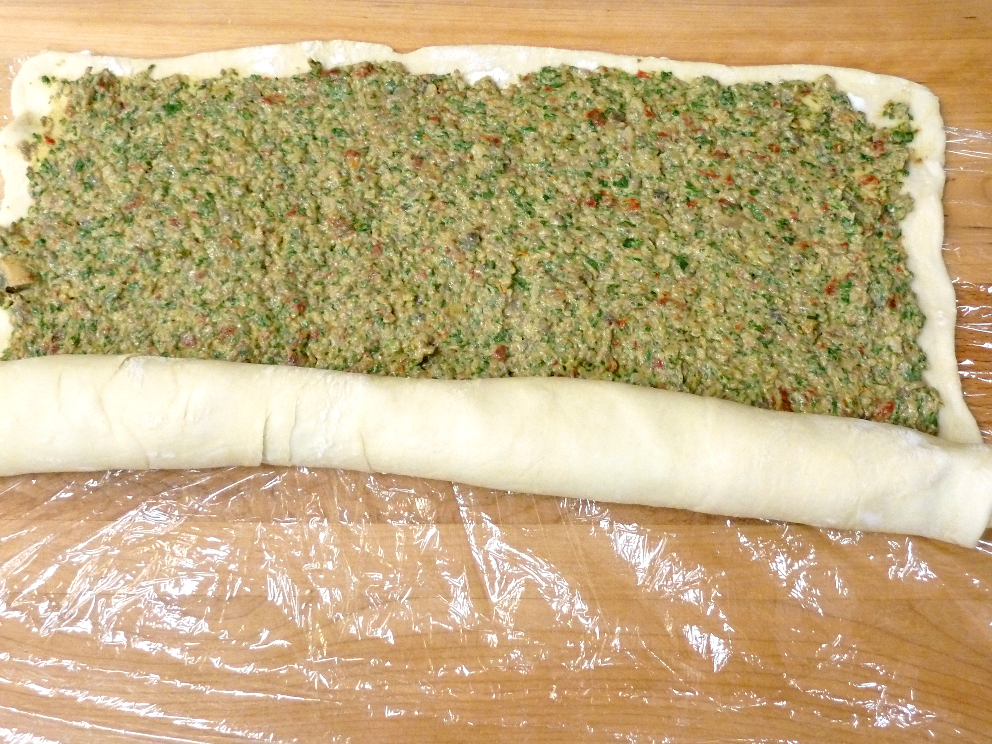 Roll the pastry into a cylinder like a jelly-roll.