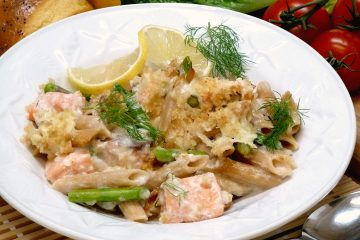 Salmon Asiago Casserole is loaded with asparagus and topped with a cheesy alfredo seafood sauce.