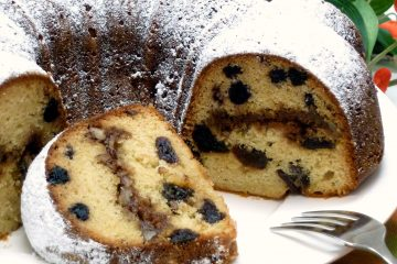 Moist and delicious Cherry Blueberry Streusel Cake is made in a Bundt pan.
