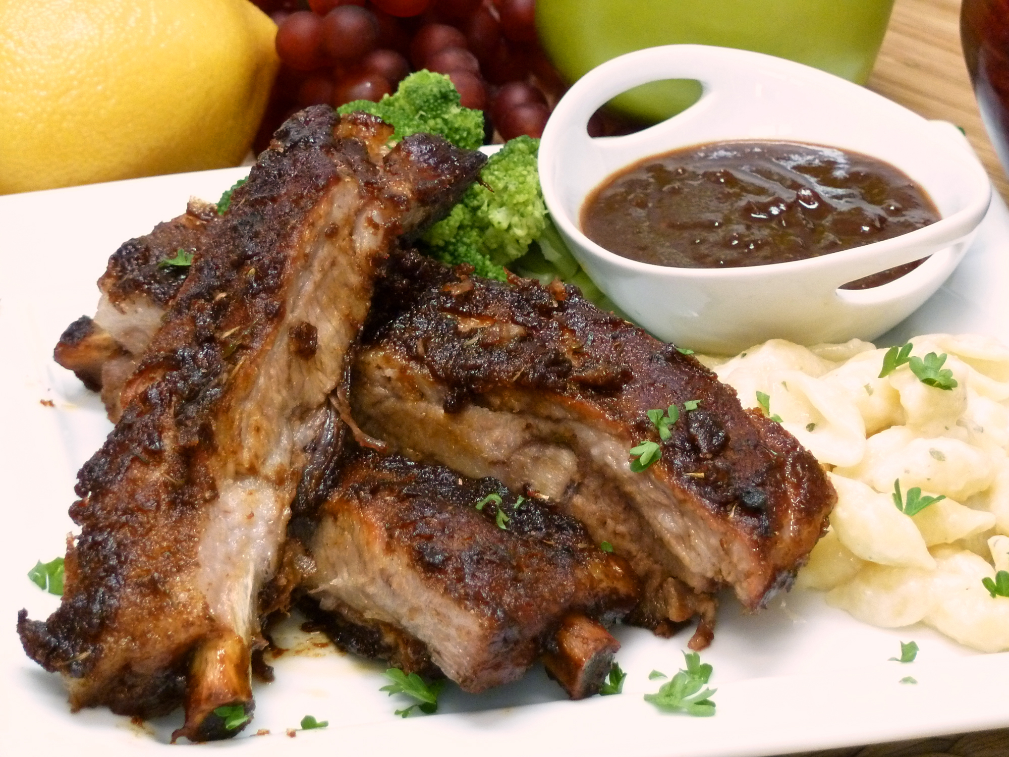 Juicy sweet and sour spareribs are baked in the oven.