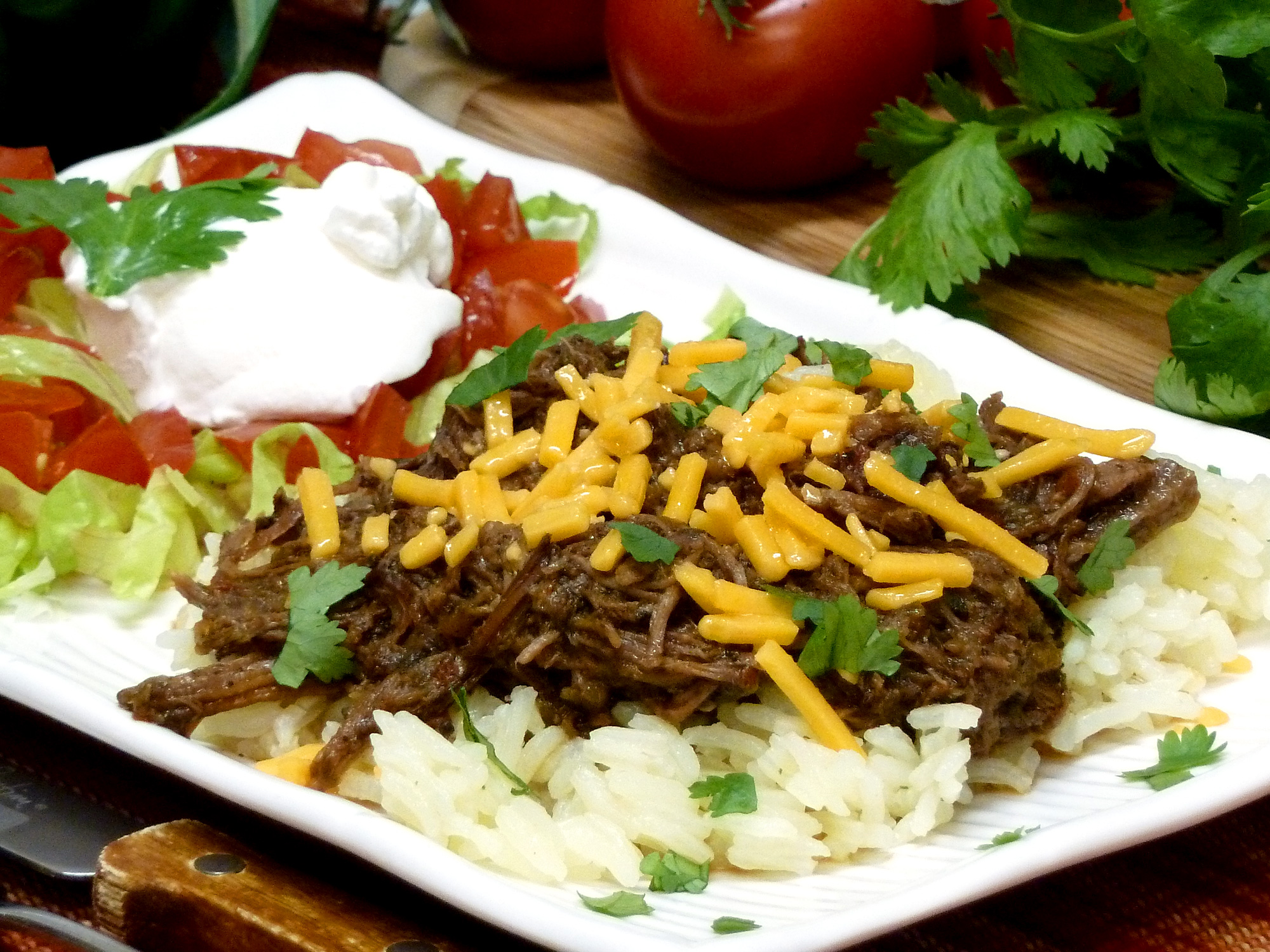 Green Chile Shredded Beef is easily made in the crockpot and may be used 10 different ways.