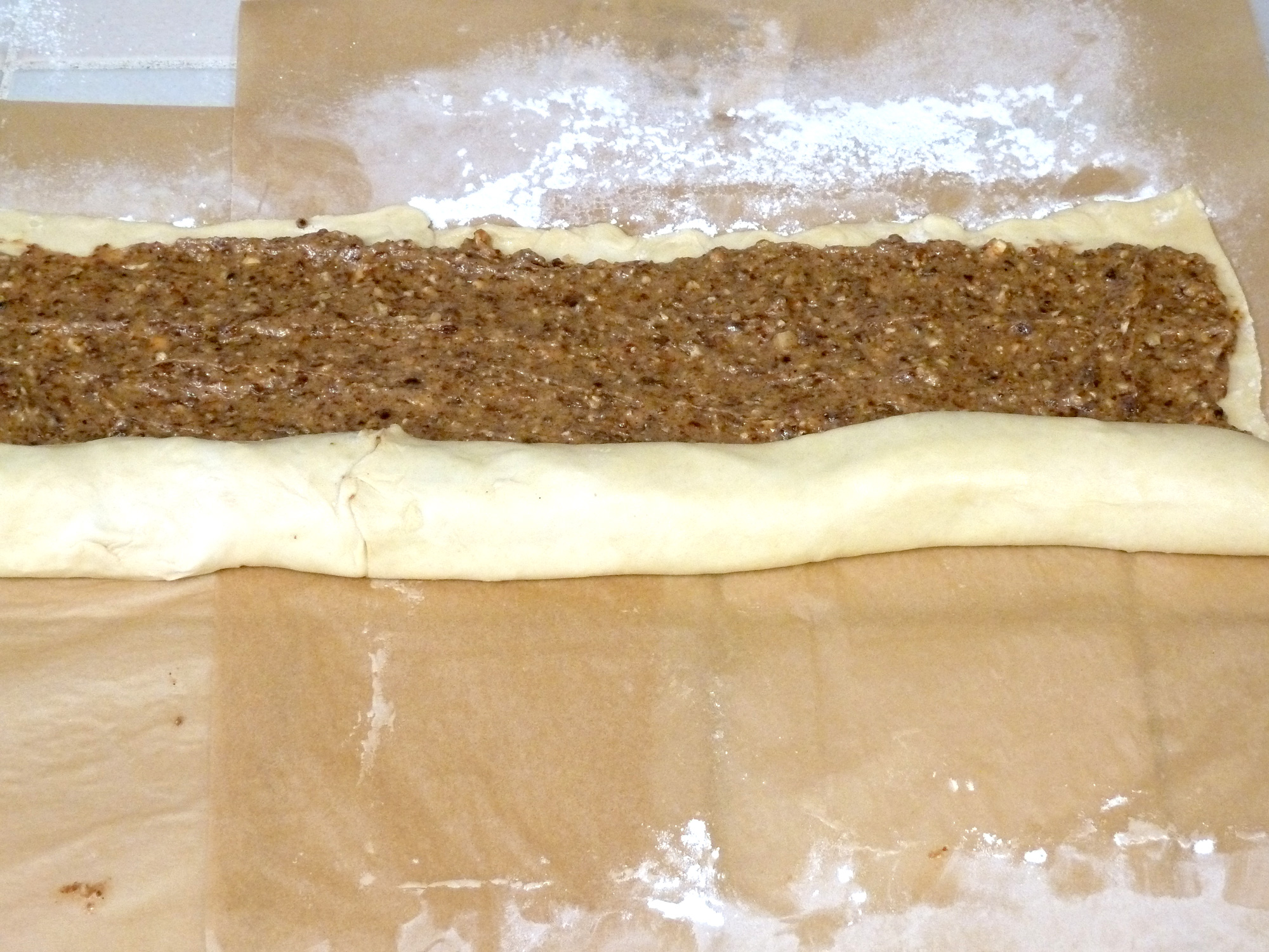 Roll the cinnamon raisin swirl puff pastry away from you into a long log.