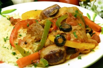 Chicken Fricassee is slow-simmered with savory vegetables, sausages, herbs, and spices.