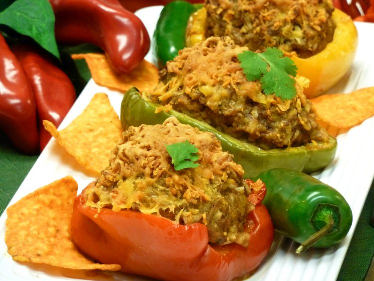 Loco Taco Stuffed Peppers are stuffed with beef, sausage, rice, nacho chips, and all of your favorite Mexican flavors.