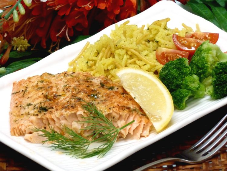Deliciously moist salmon is seasoned with butter, herbs, lemon, and Parmesan cheese.
