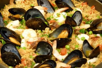 Skillet Seafood Sausage Paella is loaded with shrimp and mussels in saffron rice.