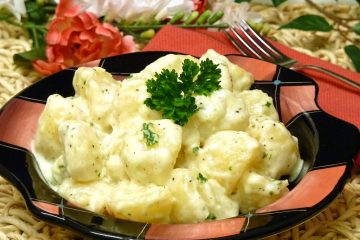 Alfredo Parsley Potatoes flaunt the rich flavors of Parmesan cheese, butter, cream, and garlic.