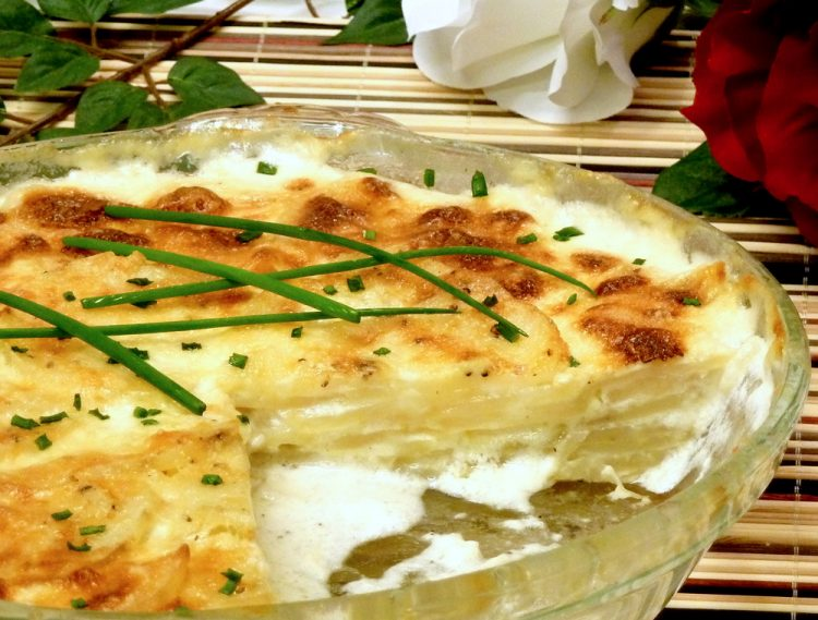 Gold Potato Pie has layers of Yukon Gold potatoes baked in a rich bath of milk, heavy cream, garlic, and Parmesan cheese for the best side dish ever.