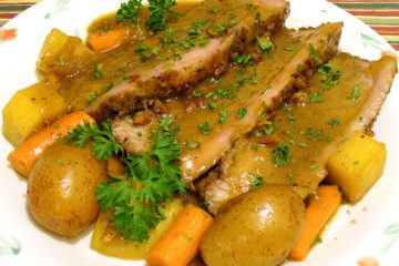 Beer braised brisket with vegetables topped with luscious gravy.
