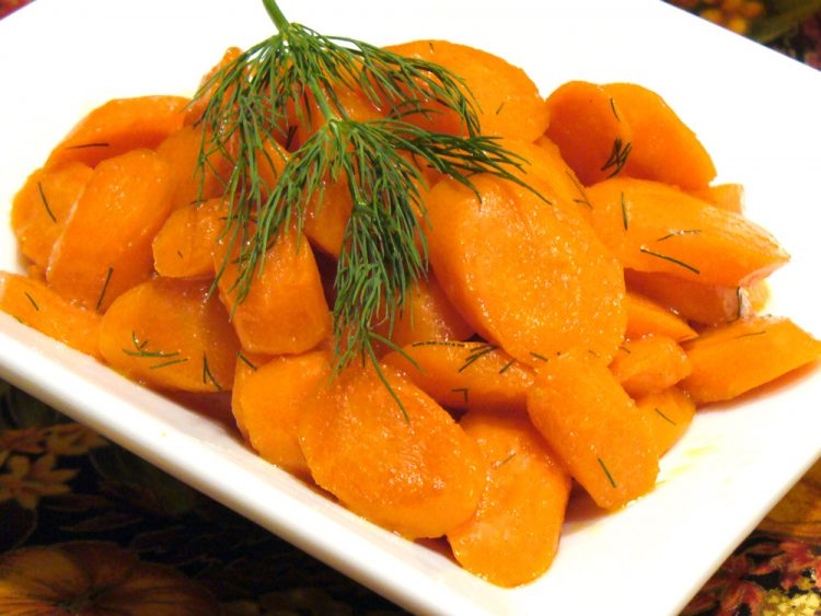 Colorful champagne dill carrots are sprinkled with fresh dill and cooked in champagne.