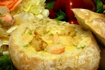 Rich and creamy, loaded with shrimp, easy shrimp bisque is served in a hearty bowl of bread.