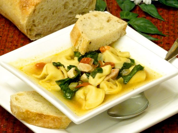 Chicken spinach tortellini soup is a colorful, filling meal in a bowl.