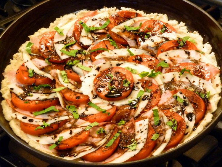 Colorful skillet flatbread boasts a yeast-less crunchy crust topped with favorite pizza toppings.