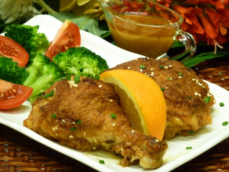Scrumptious Orange Braised Fried Chicken is golden brown, tender, and juicy.