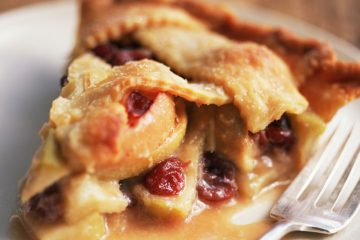 The mixture of tart cranberries with sweet raisins and apples make this yummy cranberry apple pie special.