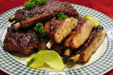 Tender, juicy baked tropical spareribs are made in the oven for a year-round taste sensation.