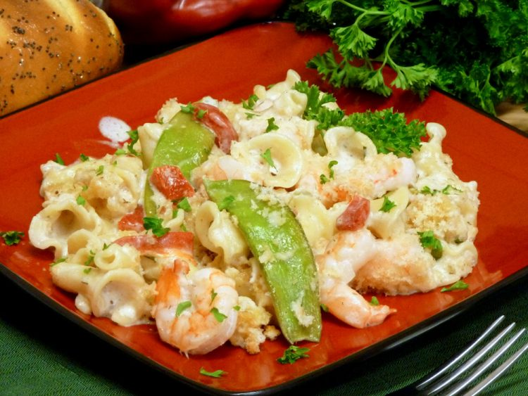 Creamy, cheesy shrimp pasta casserole is packed with flavor and gets crunch from sweet snow peas.