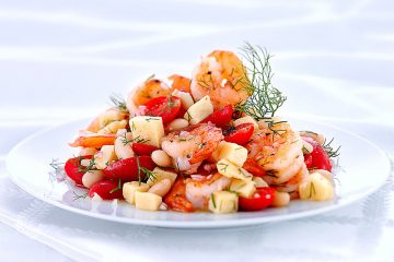 Parmesan Pan-Roasted Shrimp is mixed with a chunky medley of tomatoes, white beans, garlic, and shallots.