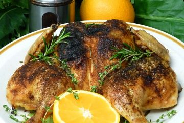 Spatchcock herb orange chicken starts with an inexpensive whole chicken and ends up tender and juicy.