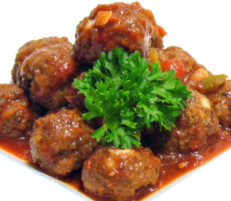 Sweet Spicy Cocktail Meatballs are bathed in an addictive 2-ingredient sauce that is a snap to make.
